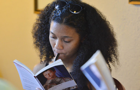 "Anisa Williams-Ranciato consults her book in a ""Citizens"" seminar"